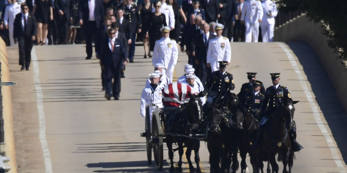 The Latest: Horse-drawn caisson carries McCain's casket