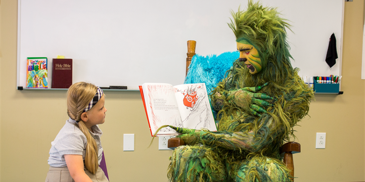 Dr. Seuss' Grinch reads to first graders in Huntsville