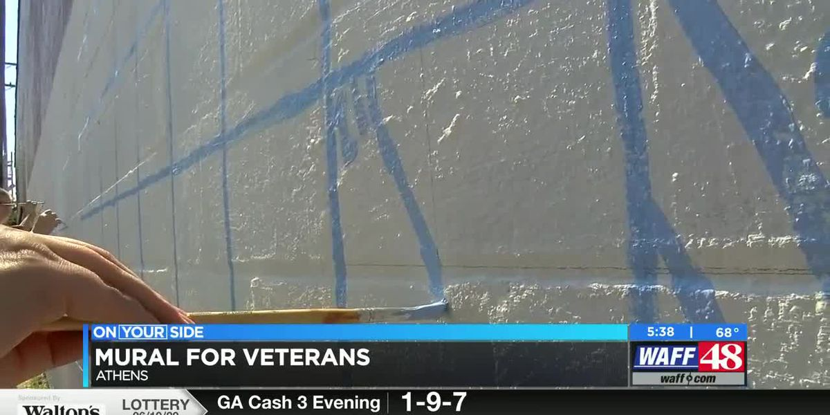 Students paint mural to honor veterans in Downtown Athens