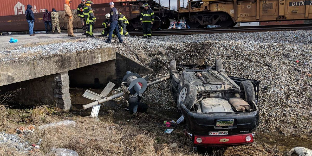 Woman injured when vehicle collides with train