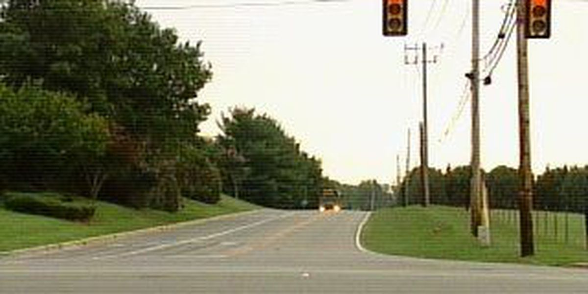 Drivers adjust to new traffic lights at busy intersection