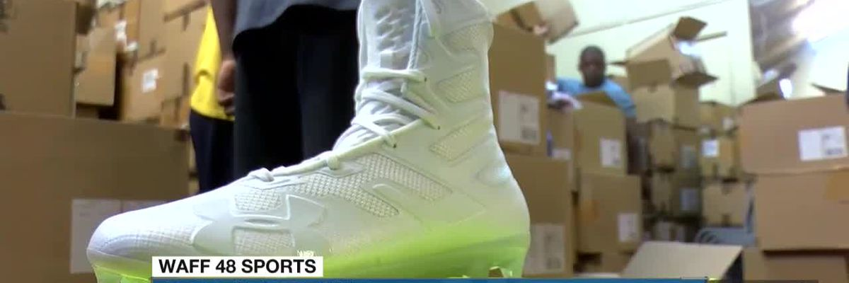 Boxes fo love: Under Armour sends boxes of cleats and gloves to Huntsville City School football team