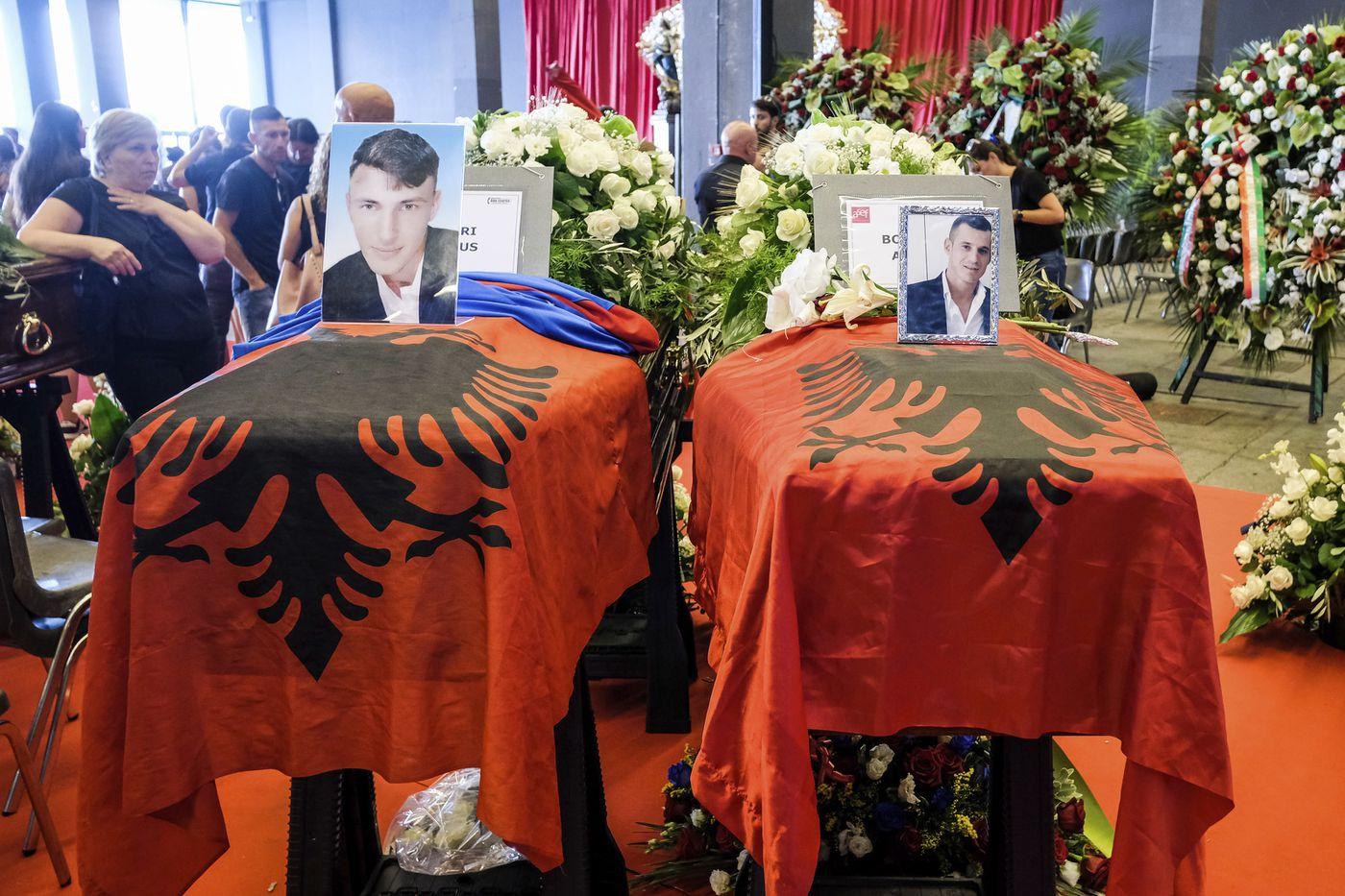 The latest romanian trucker is genoa bridges 43rd victim the coffins of edi bokrina and marius djerri left are draped with the albanian izmirmasajfo