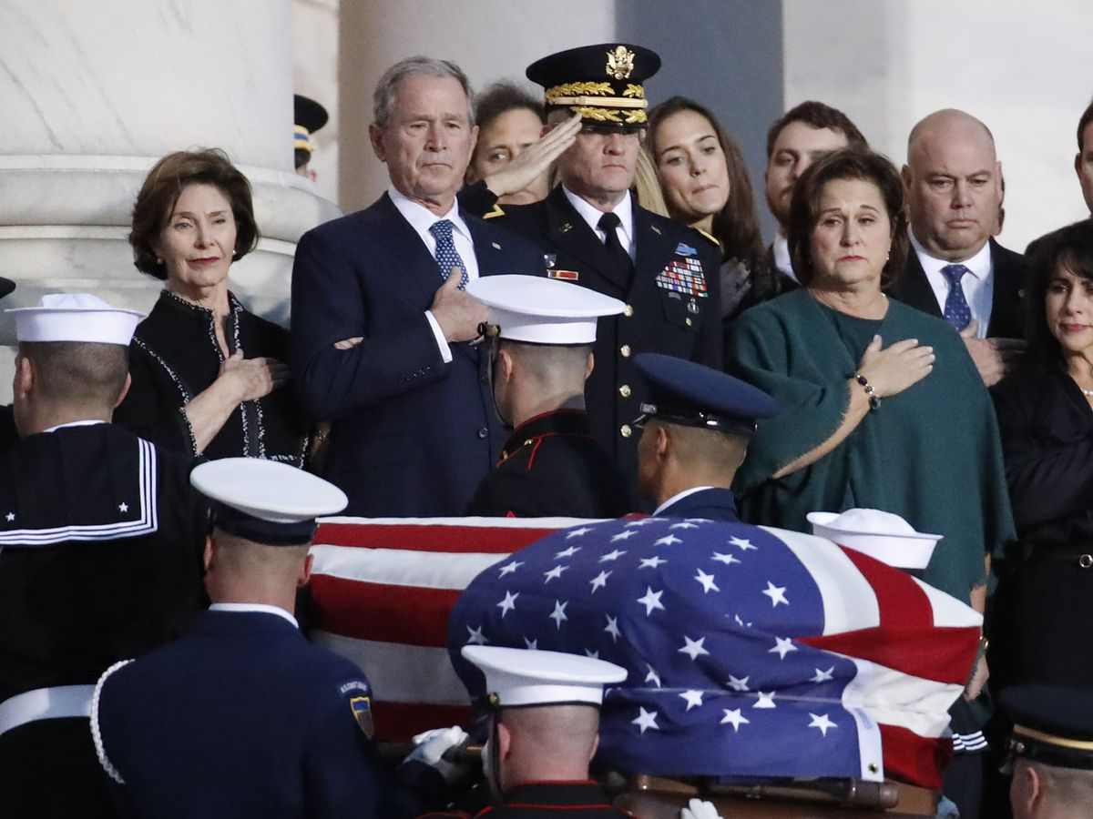 'A great leader who made a great difference': George HW Bush lies in state after eulogies from Pence, others