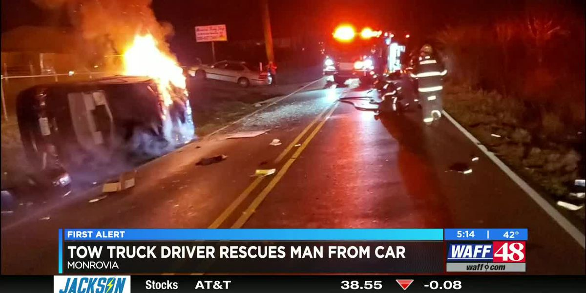 VIDEO: Tow truck driver praised for rescuing man from burning car