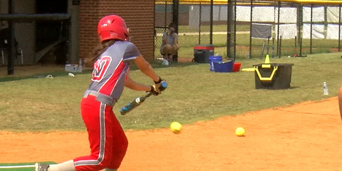 Softball players learn the art of slap hitting