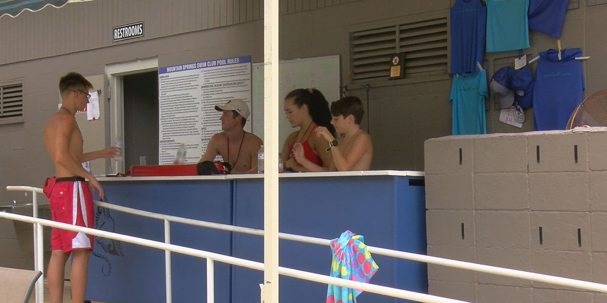 Lifeguards keeping themselves safe, while also watching out for swimmers