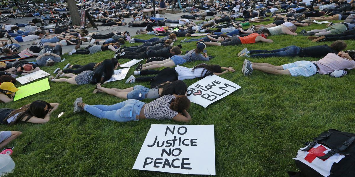 Protests turn subdued after new charges in Floyd case