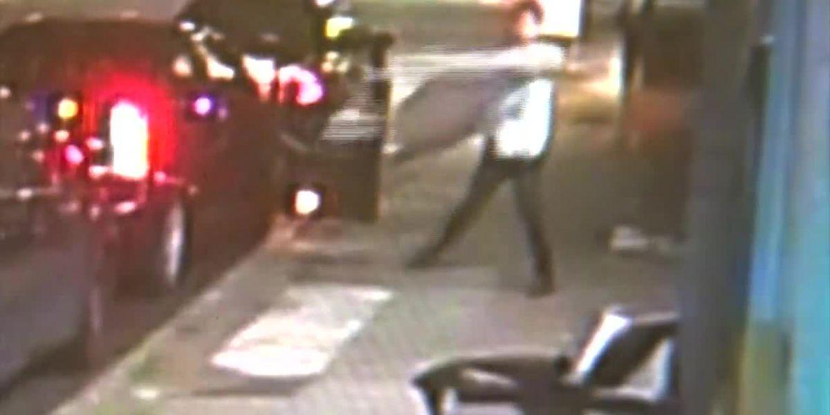 Man parked next to 'no parking' sign hurls it at restaurant window