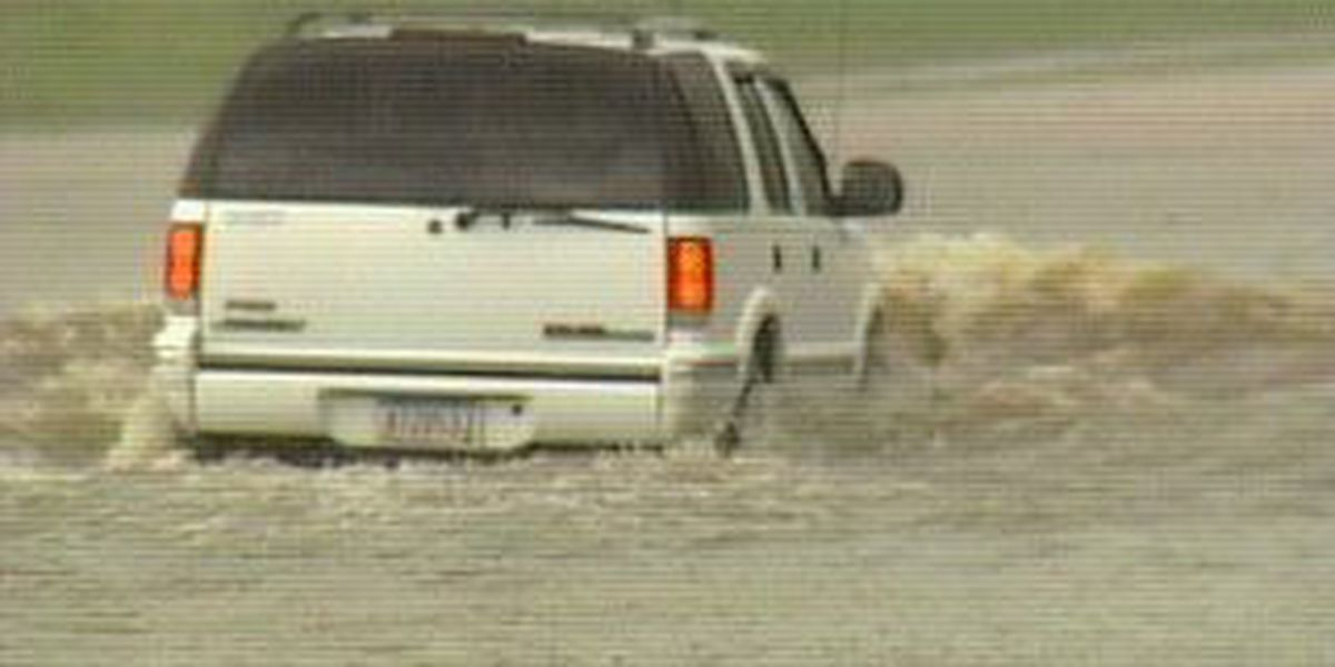 Tow truck driver saves family from flood waters