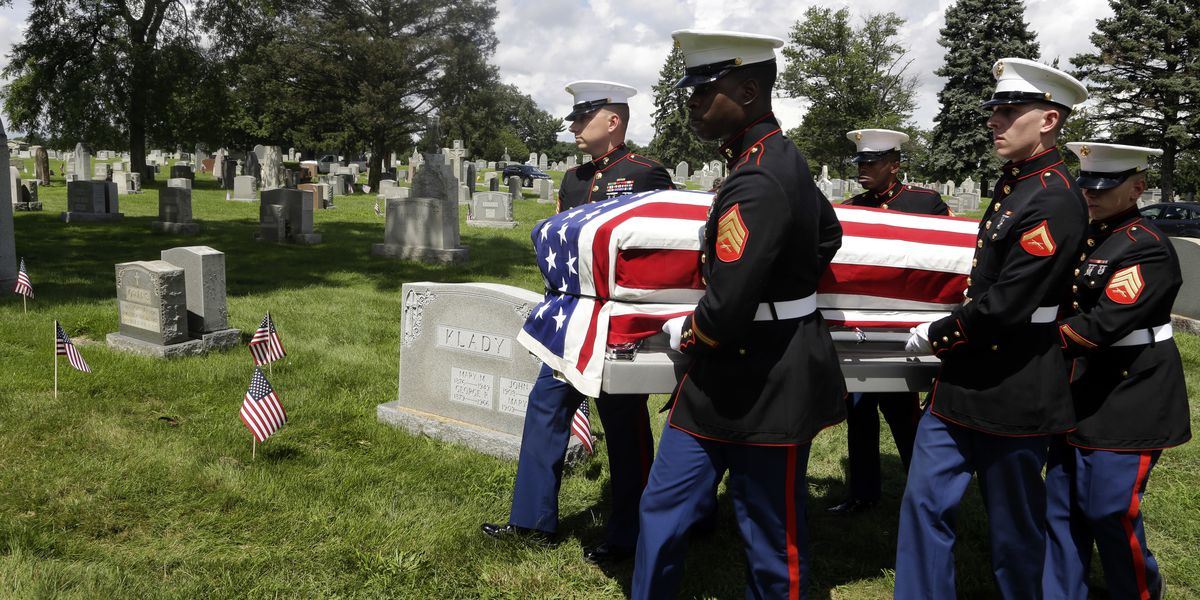 2 brothers pay respects as Marine killed in WWII is buried