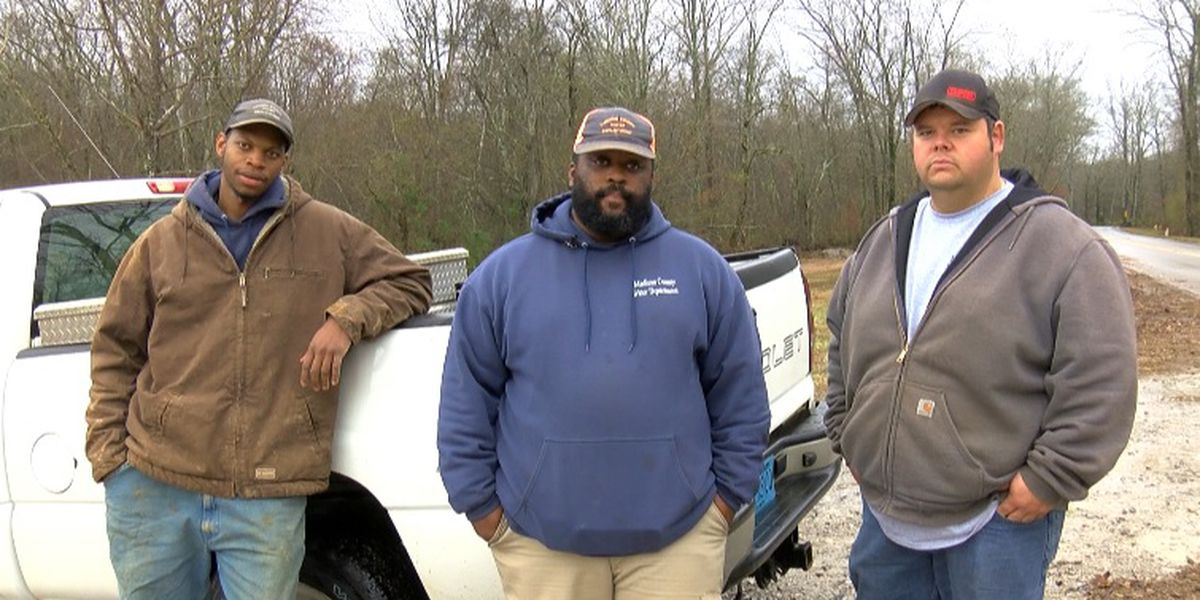 Madison Co. workers rescue woman from sinking car in floodwaters