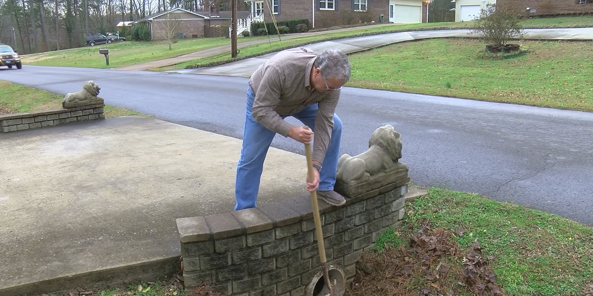 Scottsboro residents remove debris from drains due to flooding