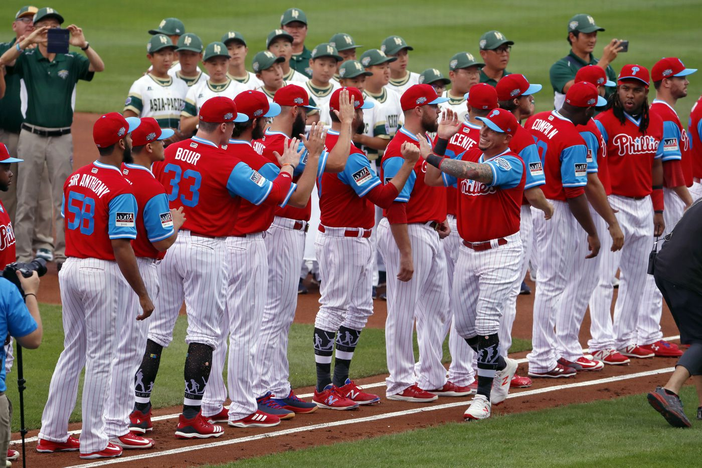 d1db0fdd2 Philadelphia Phillies  Asdrubal Cabrera takes his place along the first  baseline with teammates after being