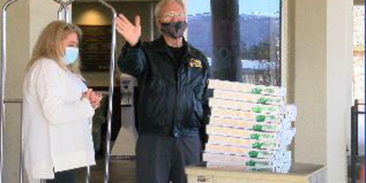 Organization donates 45 pizzas and desserts to veteran's home
