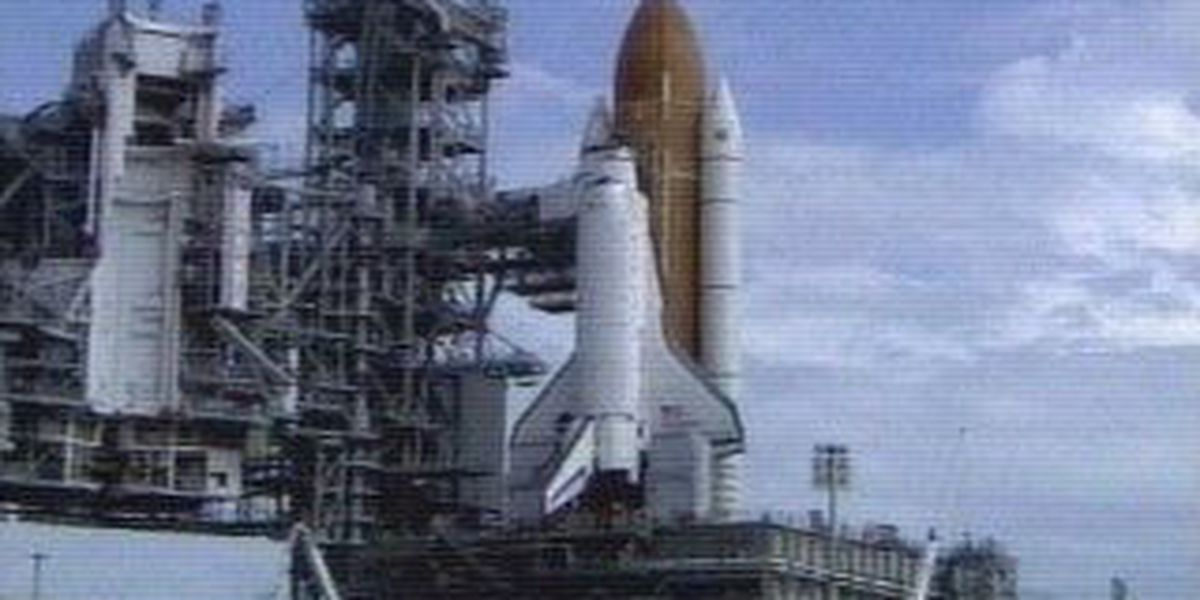 Shuttle launch delayed, crew arrives at space center