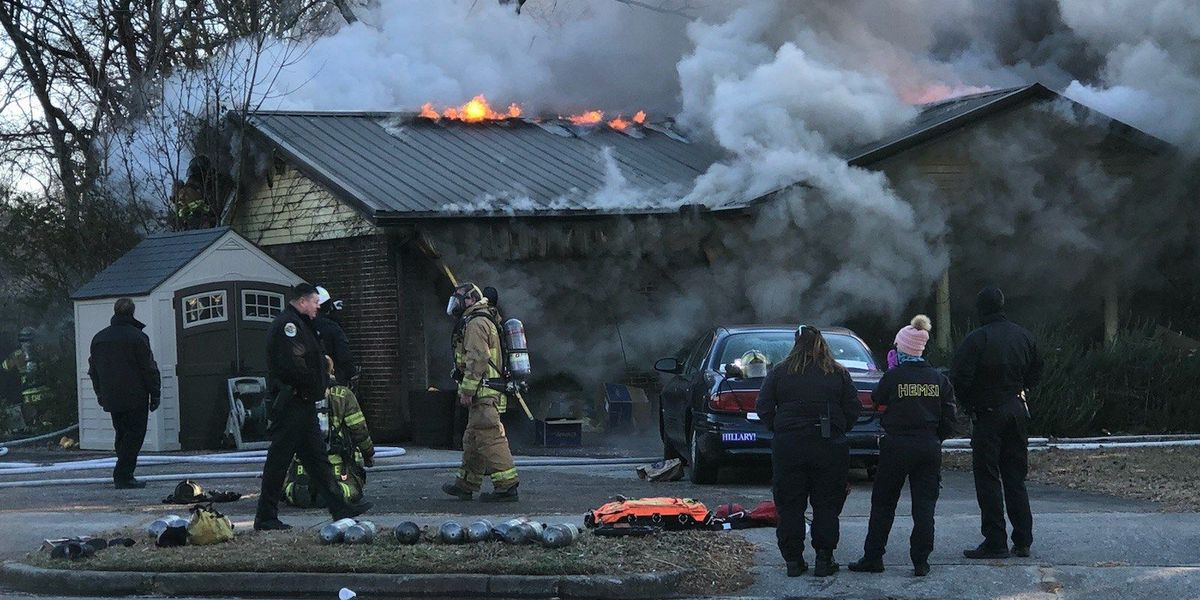 Woman, dog escape house fire in south Huntsville
