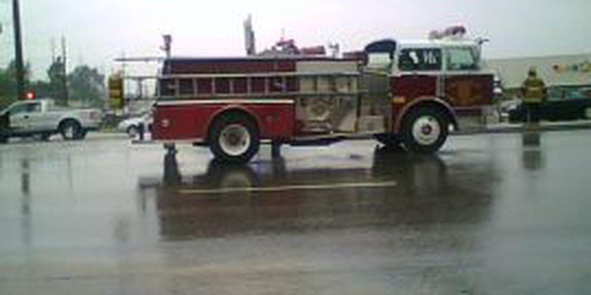 Vehicle slides into Huntsville Fire truck