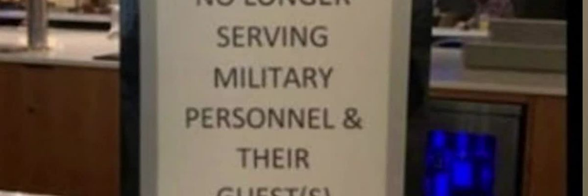 Hotel apologizes for sign refusing military members