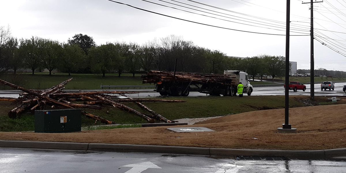 Log truck loses its load on Highway 72 in Madison County
