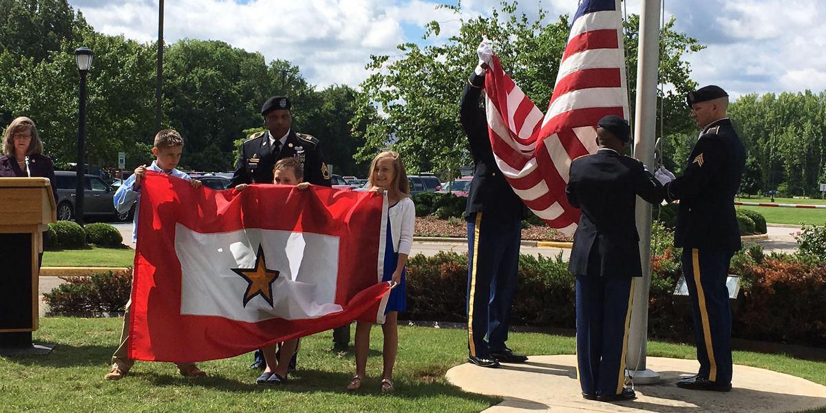 Children raise Gold Star flag in late father's honor