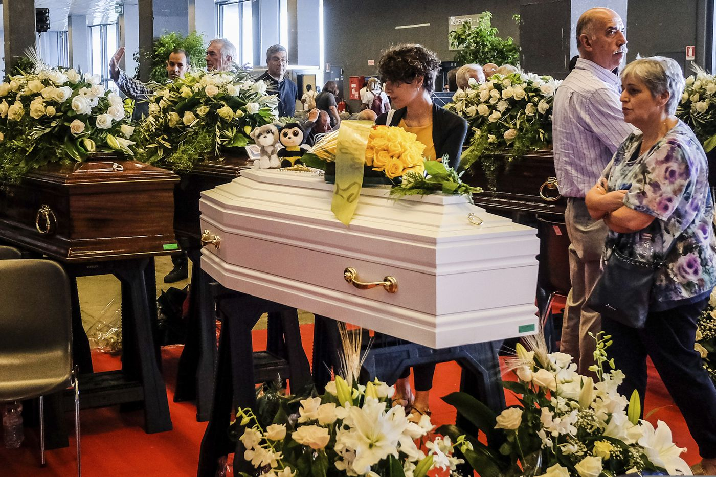 The latest romanian trucker is genoa bridges 43rd victim mourners stand by a small white coffin prior to the funeral service of some of the izmirmasajfo