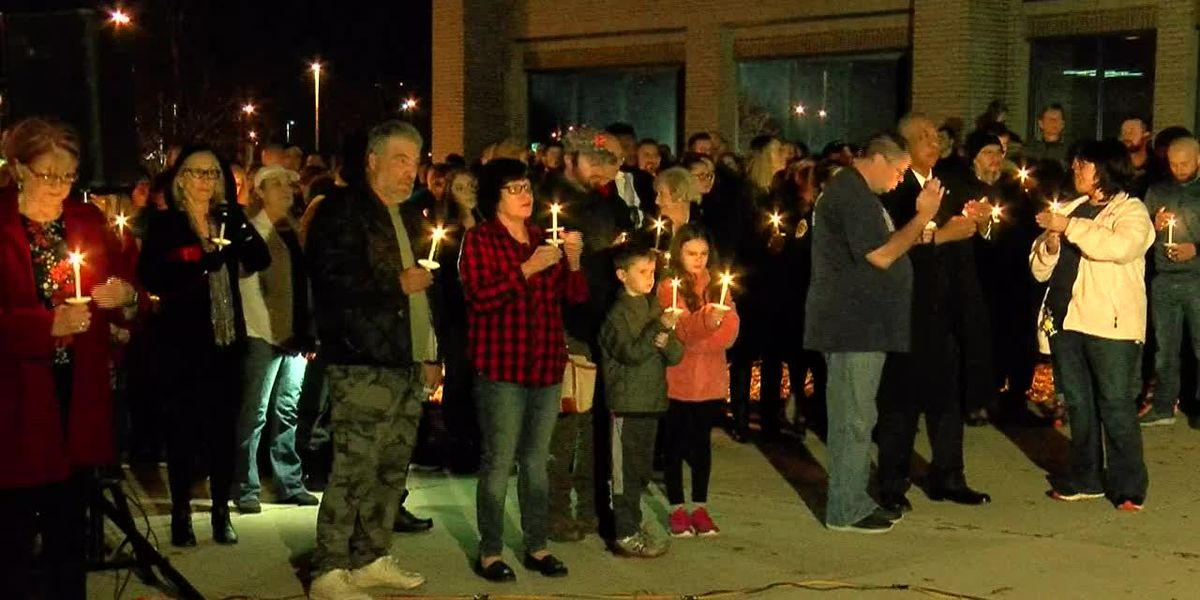 Community members and police honor fallen police officer at candle light vigil
