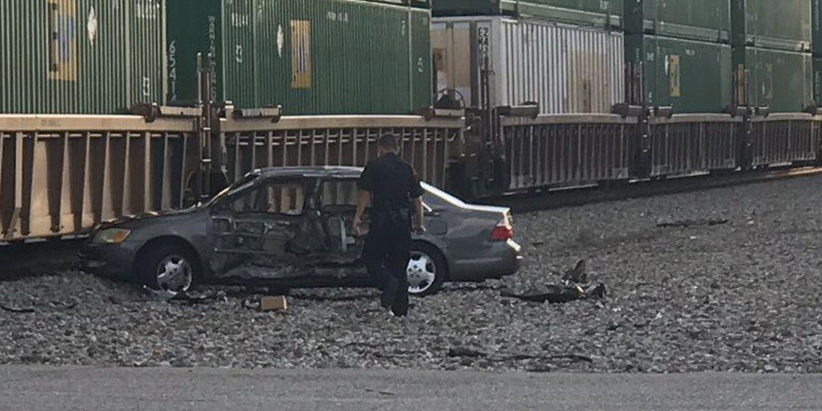 Car hit by train in downtown Huntsville