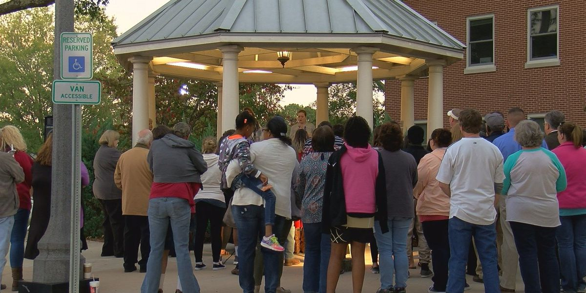 Woman shares story of survival at domestic violence candlelight vigil