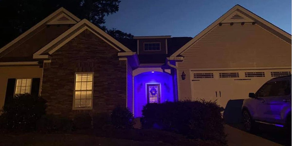 Fallen Ala. officer's neighborhood turns blue in his memory