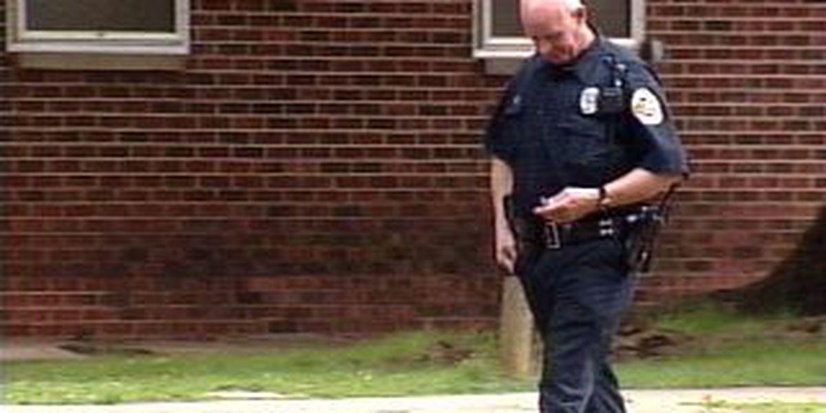 Shooter sought in housing complex murder