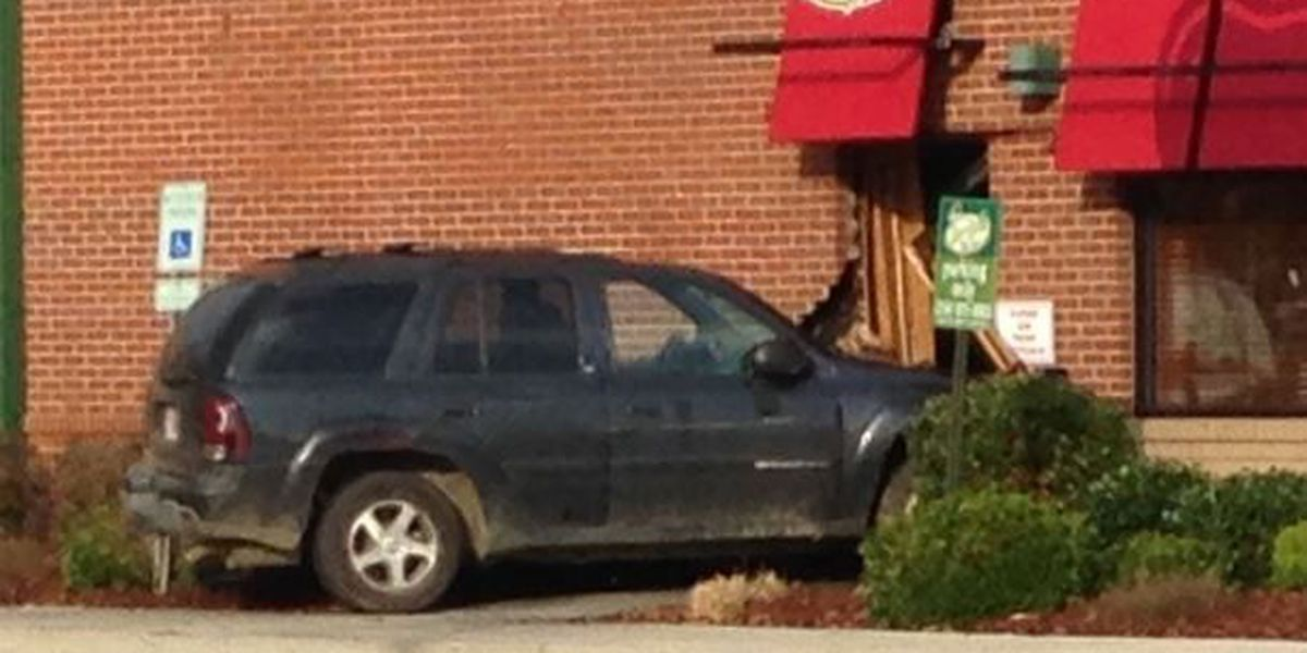 1 taken to hospital, driver charged with DUI after SUV crashes into Applebee's